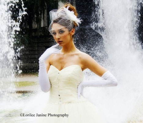 This 60s-inspired 'bouffant' bun tops the bride's head like a crown of