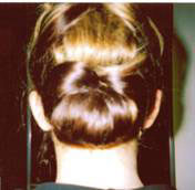 Bow bun by Hair and Spa in Motion
