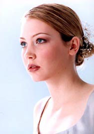 Another romantic Low Bun bridal hairstyle, by Featuring You Spa & Salon, Toronto