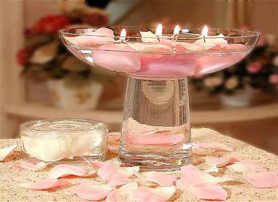 Floating candle wedding centrepieces